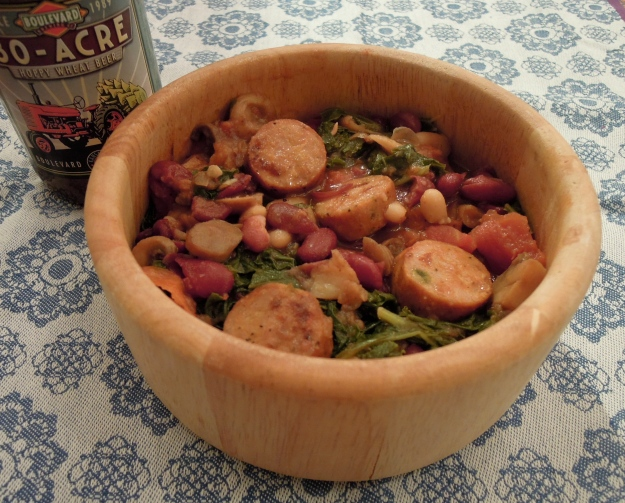 Sausage, kale, mushrooms, kidney beans, cannelini beans, and tomatoes.