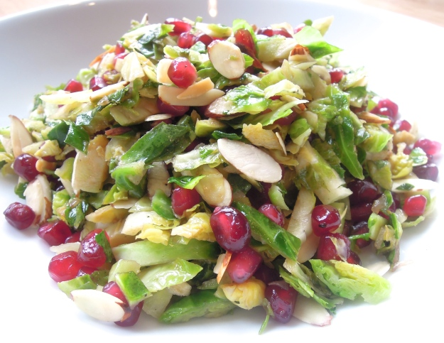 Sauteed Shredded Brussels Sprout Salad with Toasted Almonds & Pomegranate Seeds