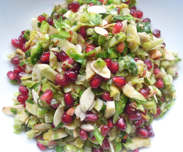Shredded Brussels Sprout Salad with Toasted Almonds & Pomegranate Seeds